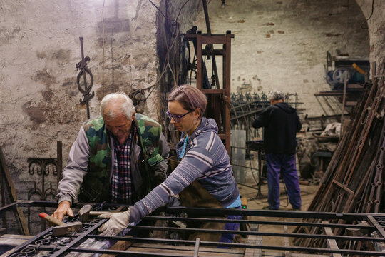 Father And Daughter, Co-Workers in Blacksmith Workshop