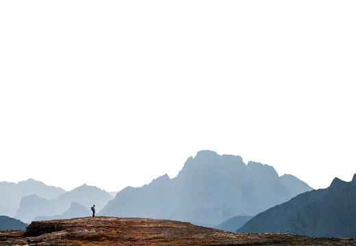 Mountains range silhouette with winy person