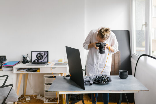 Female photographer working in a studio