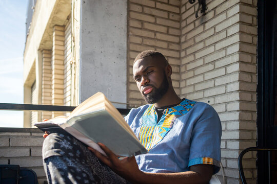 Man Reading A Book At Home.