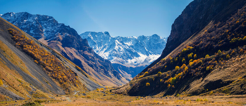 North Ossetia, Russia, Kurtatinsky gorge. View through the gorge to the snow-capped mountains
