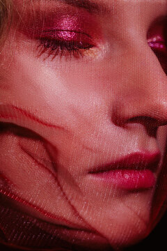 Crop beauty portrait with red veil