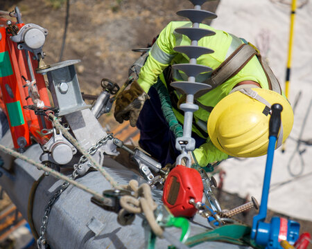 Lineman Working from Steel Pole