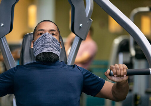 Gym: Man Wears Mask While Working Bench Press