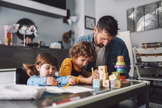 Father with his children drawing a picture