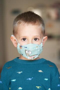 Charming boy wearing medical mask for kids
