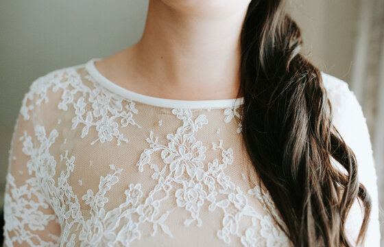 closeup of a beautiful bride with lace dress