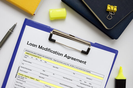 Financial concept meaning Loan Modification Agreement with phrase on the business paper