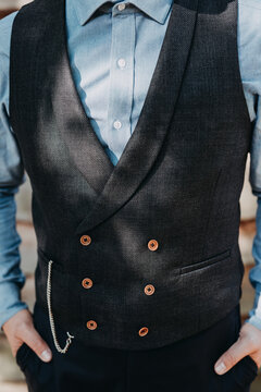 closeup of groom with blue suit and shirt