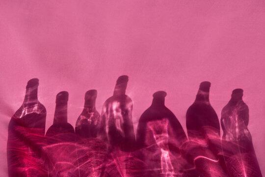 Bottles shadows on pink background