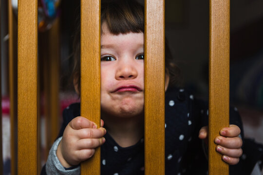 Toddler Making Angry Face In Crib