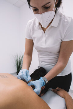 Woman physiotherapist doing a dry needling technique