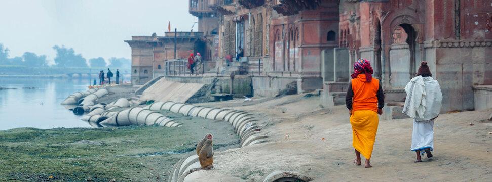 Vrindavan India January 2020: Pilgrims on the river near the temple. Krishna Temple at the Keshi Ghat on Yamuna river