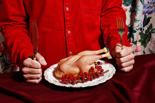 man eating a fake roast turkey
