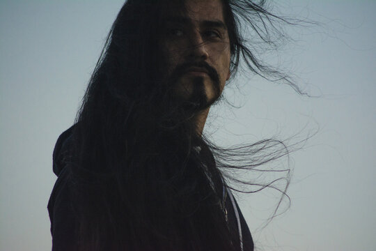 Long haired man at twilight