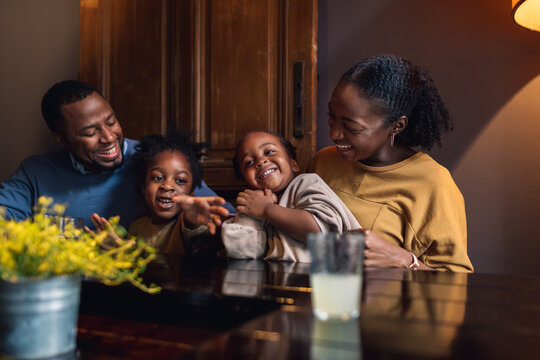 A Family of Four Laughing in a Restaurant
