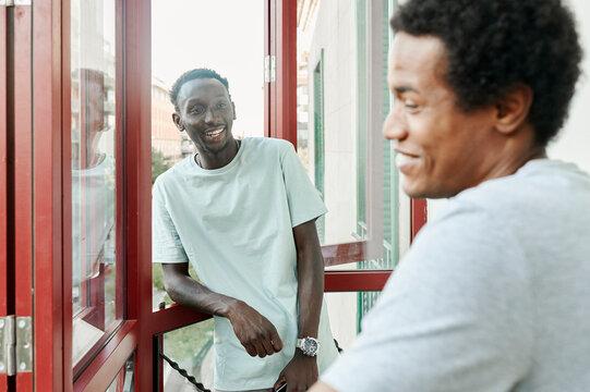 Friends talking on a hostel balcony