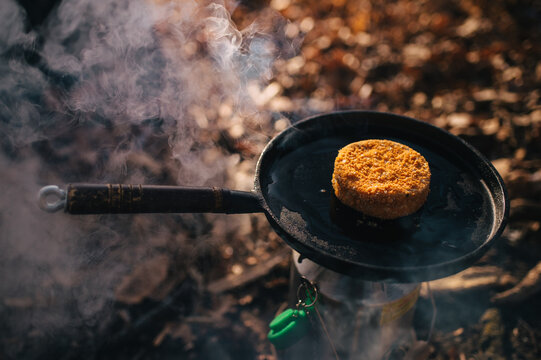 cooking cheese with breading in the camping open fire kitchen