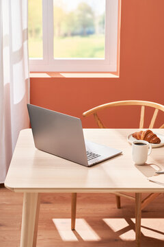 Modern workplace during breakfast at home