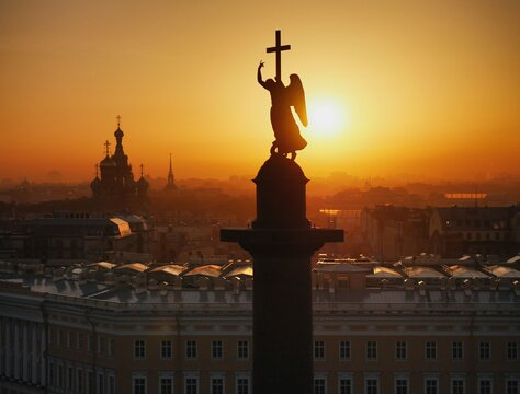Angel holding christian cross atop the Alexander Column in St. Petersburg, Russia.