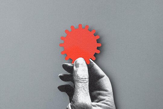 Hand holding a corona virus