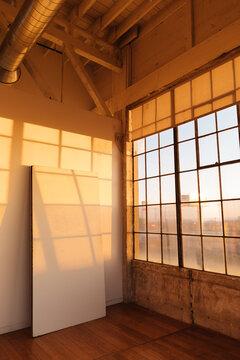 Golden hour in urban industrial photo loft space
