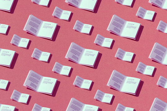 Open books make by paper craft isolated seamless pattern on color background