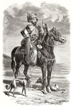 Kurdish falconer. Posing horseback with his equipment and fast slim hunting dogs on a flatland. Grey tone etching style art by Duhousset, Le Tour du Monde, 1862