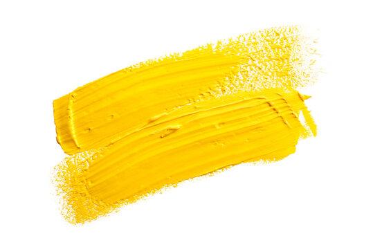 Yellow paint splatter isolated on white background
