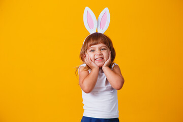 Little blonde girl with bunny ears. Happy Easter concept!