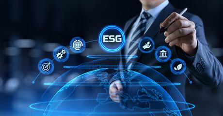 ESG environmental social governance business strategy investing concept. Businessman pressing...