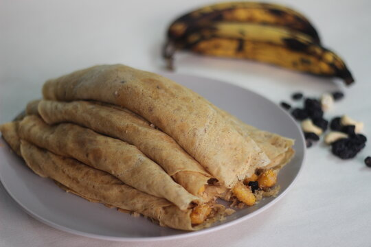 Home made Plantain Crepes or pancake with plantain coconut raisins mix in the middle.