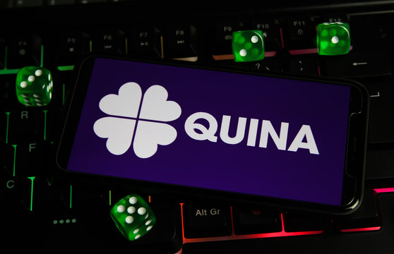 Viersen, Germany - March 1. 2021: Closeup of smartphone with logo letterin of brazil quina lottery game on computer keyboard