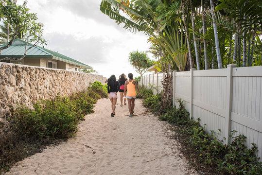 Friends walking on sandy path, Lanikai Beach, Oahu, Hawaii