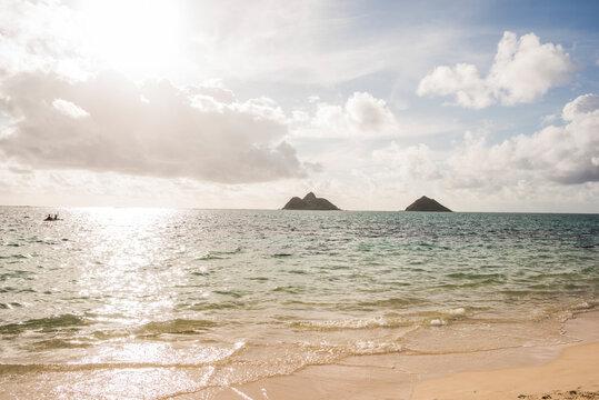 Kayakers in sea, Lanikai Beach, Oahu, Hawaii