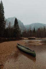 Canoe beached on river shallows, Yosemite Village, California, USA