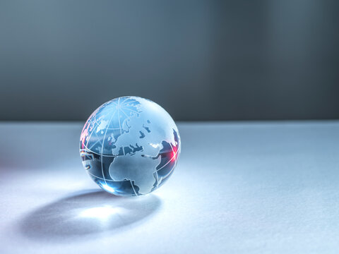 A glass globe of planet Earth illustrating global trade and networking.
