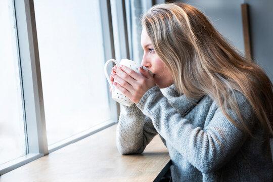 Woman having tea in cafe
