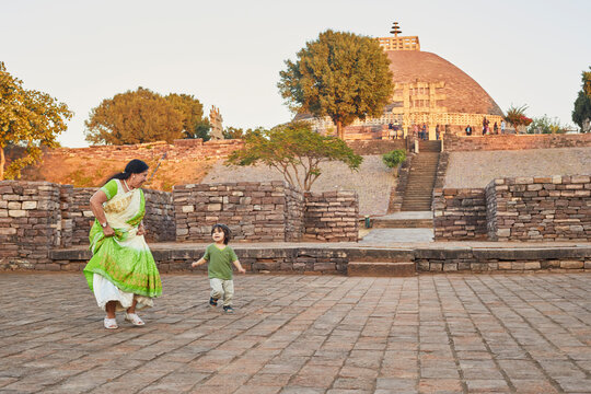 Grandmother playing with grandson at square, Bhopal, Madhya Pradesh, India