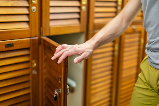 Man opening locker door