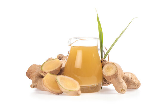 Ginger root or zingiber officinale and oil isolated on white background.