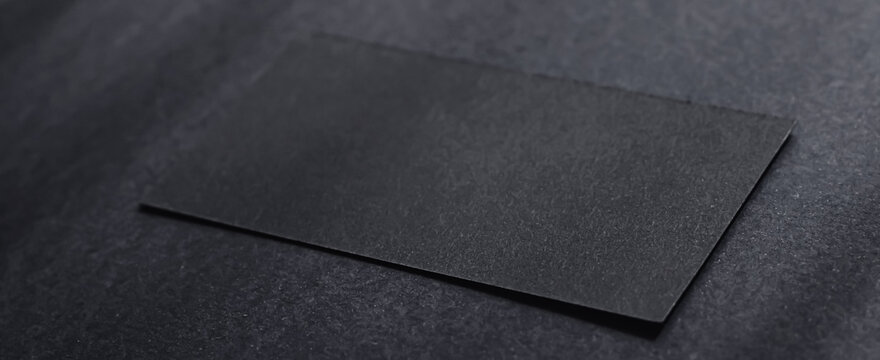 Black business card on dark flatlay background and sunlight shadows, luxury branding flat lay and brand identity design for mockups