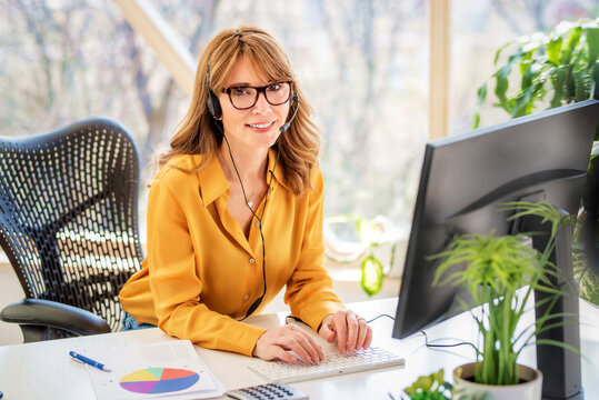 Shot of call center agent operator businesswoman working from home
