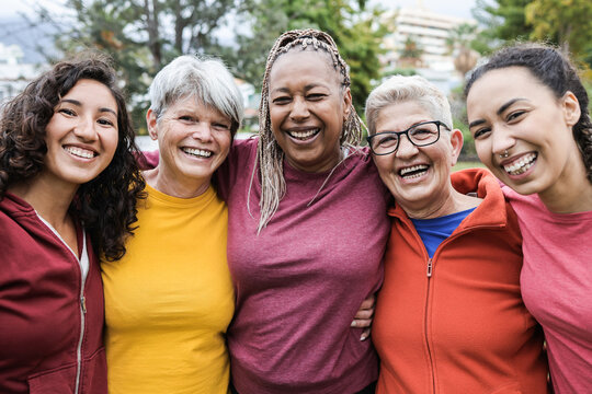 Happy multi generational women having fun together - Multiracial friends smiling on camera after sport workout outdoor - Main focus on african female face