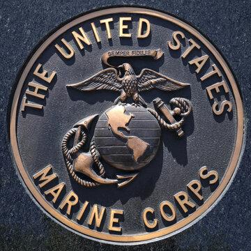 Los Angeles, California  USA - March 12 2019: U.S. Marine Corps logo or emblem, crest or plaque on black granite background