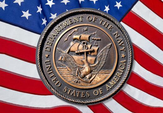 Los Angeles, California  USA - March 12 2019: U.S. Navy logo or emblem  on American Flag background