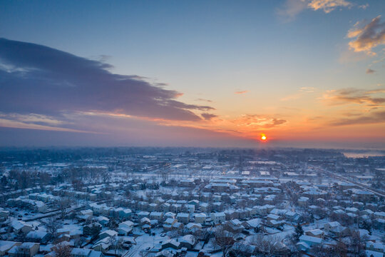 sunrise over city of Fort Collins in after heavy snowstorm, aerial view of late winter or early spring scenery