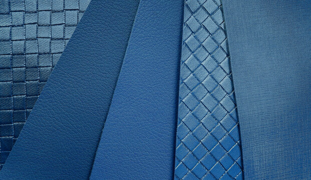 close up blue leather samples swatch with rough and weave pattern. leatherette sample for interior upholstery works.