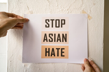 Stop Asian Hate sign attached on the wall