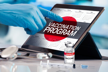 Working with tablet in the program of the vaccination schedule for Japan. Photomontage with 3d...